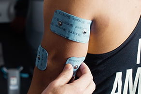 Compex electrodes on a person's elbow